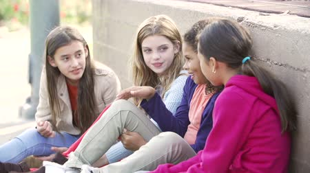 четыре человека : Four Young Girls Hanging Out Together In Park