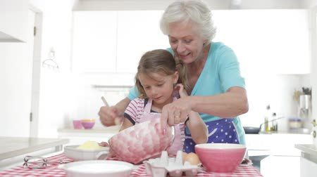 бабушка : Grandmother And Granddaughter Baking In Kitchen