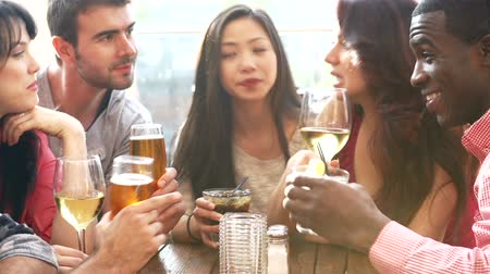 piwo : Group Of Friends Enjoying Drink At Outdoor Rooftop Bar