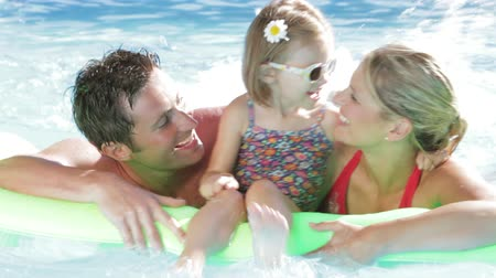 holidays : Family On Holiday In Swimming Pool Stock Footage