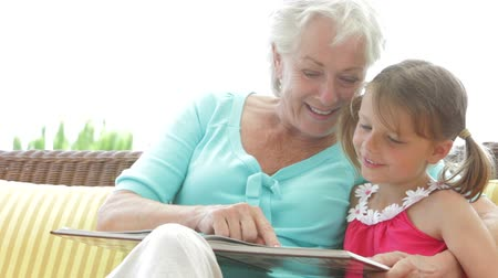 бабушка : Granddaughter Reading Book With Grandmother