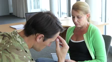 counselling : Soldier Talking To Female Counsellor In Office