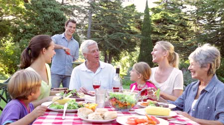 grillowanie : Multi Generation Family Enjoying Barbeque In Garden