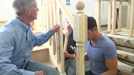 helping : Mature Students In Carpentry Class Working On Staircase