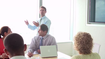 eleven people : Motivational Speaker Talking To Businesspeople In Boardroom Stock Footage