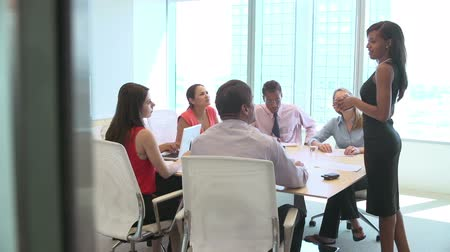 discussion meeting : Seven Businesspeople Having Meeting Around Boardroom Table Stock Footage