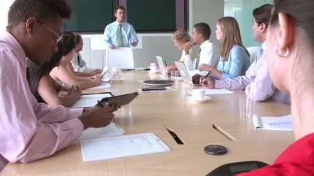eleven people : Group Of Businesspeople Meeting Around Boardroom Table Stock Footage