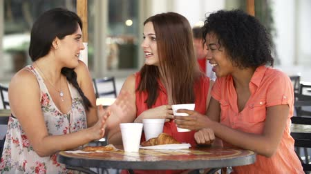people talking : Three Female Friends Meeting In Café In Slow Motion