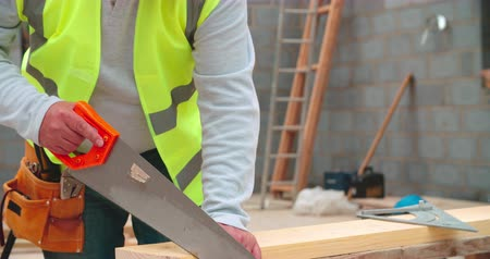 cutting up : Close Up Of Carpenter Measuring And Cutting Wood On Site
