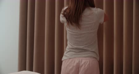 pizsama : Woman Standing By Bedroom Window In Morning And Stretching