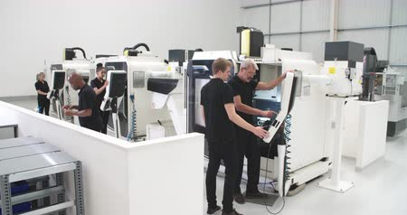 mühendislik : Busy Engineering Workshop With CNC Machines And Operators