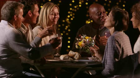 talk : Mature Friends Enjoying Outdoor Evening Meal Shot On R3D