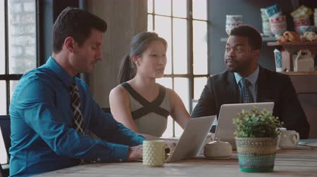 Three Businesspeople Working At Laptops In Café Shot On R3D