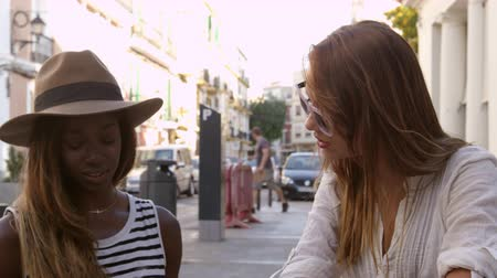 двадцатые годы : Three female friends read guidebook outside a cafe, Ibiza, shot on R3D