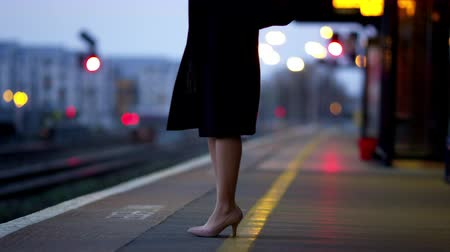 train workers : Businesswoman On Platform Waiting For Train Shot
