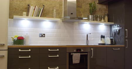 exposed brickwork : Kitchen In Modern Stylish Apartment Stock Footage