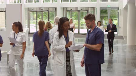 reception : Staff In Busy Lobby Area Of Modern Hospital Shot On R3D