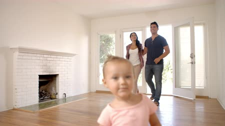 Excited Family Explore New Home On Moving Day Stok Video