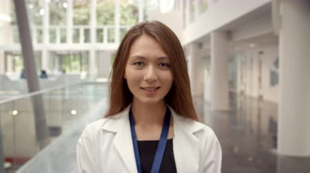 lobby : Portrait Of Smiling Female Doctor In Lobby Of Hospital Stock Footage