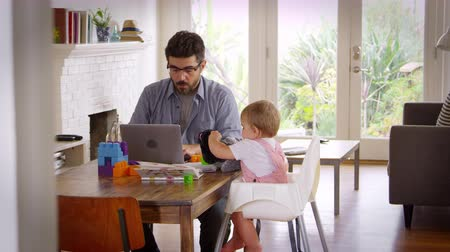 gibi : Father Working From Home On Laptop As Son Plays With Toys