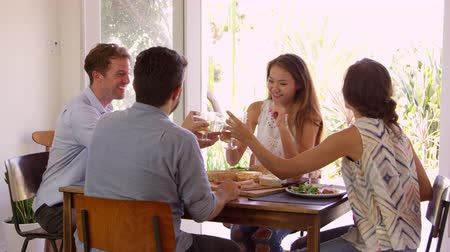 nativo americano : Group Of Friends Enjoying At Dinner Party Making A Toast