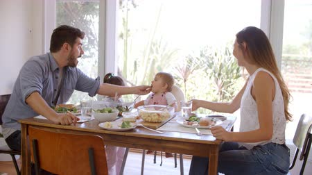 nativo americano : Family Enjoying Meal At Home Together Shot In Slow Motion