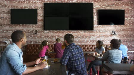сороковые годы : Friends Watching Game In Sports Bar On Screens Shot On R3D
