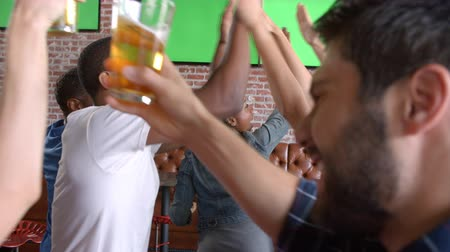 сороковые годы : Friends Watching Game In Sports Bar Shot In Slow Motion