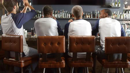 сороковые годы : Rear View Of Male Friends Watching Game In Sports Bar