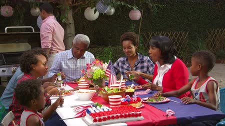 dziadkowie : Multi generation black family at table for 4th July barbecue, shot on R3D