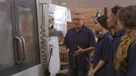 machinist : Engineer Training Apprentices On CNC Machine Shot On R3D Stock Footage