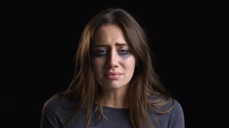 smudged : Studio Portrait Shot Of Crying Woman With Smudged Make Up Stock Footage