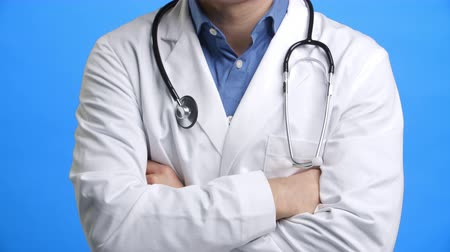 dobrado : Studio Shot Of Male Doctor Wearing White Coat