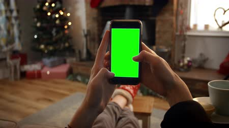 oxfordshire : Woman On Line With Mobile Phone In Room Ready For Christmas Stock Footage