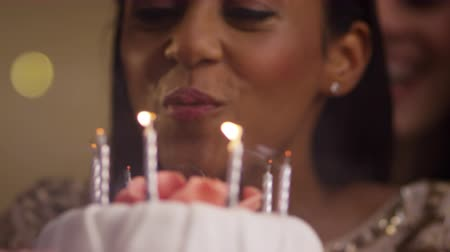 brazil : Woman Blowing Out Candles On Birthday Cake Stock mozgókép