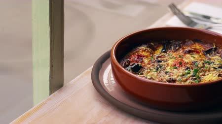 eggplant : Aubergine, feta and tomato bake in earthenware dish, pan