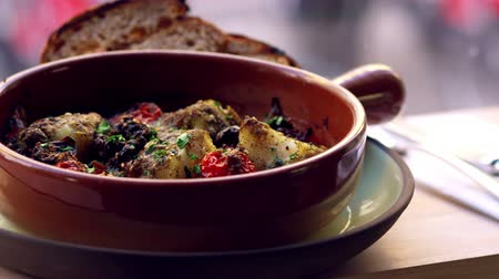 morina : Cod and chorizo bake with sourdough bread by window, pan Stok Video