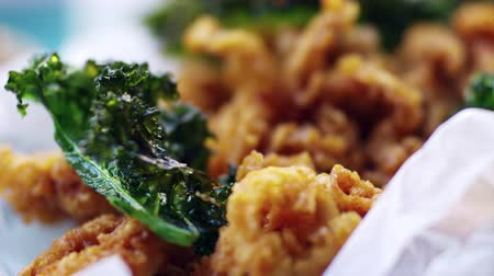 tempura : Fried baby squid with kale, extreme close up, rack focus Stock Footage