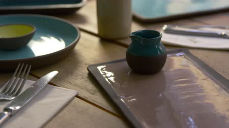 столовые приборы : Handmade earthenware on restaurant table, camera slider shot