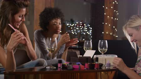 socialising : Female friends hanging out and doing their nails at home, shot on R3D Stock Footage