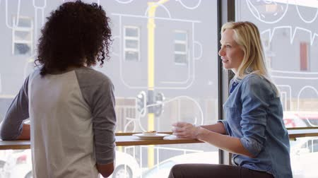 breaktime : Two Female Friends Meeting In Coffee Shop Shot In Slow Motion Stock Footage