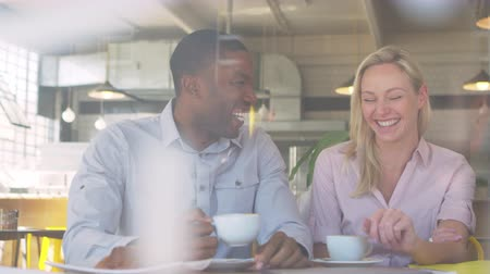 breaktime : Couple Meeting For Date In Coffee Shop Shot Through Window Stock Footage
