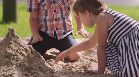 breaktime : Pupils At Montessori School Playing In Sand Pit At Breaktime Stock Footage