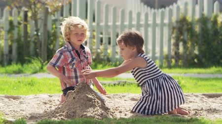 cova : Pupils At Montessori School Playing In Sand Pit At Breaktime Stock Footage