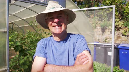 self sufficiency : Portrait Of Senior Male Gardener Outside Allotment Greenhouse