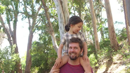 machos : Daughter Riding On Fathers Shoulders On Countryside Walk