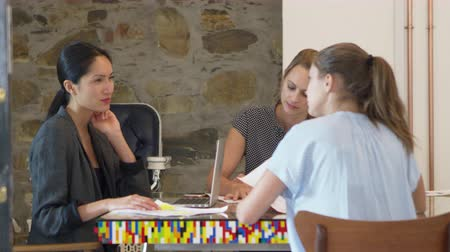 taş duvar : Three women working together with documents in a boardroom Stok Video