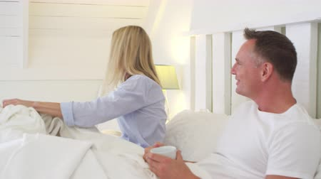 pizsama : Woman Getting Out Of Bed To Open Curtains In Bedroom