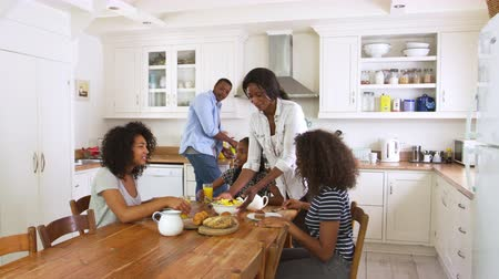 croissants : Family With Teenage Children Eating Breakfast In Kitchen