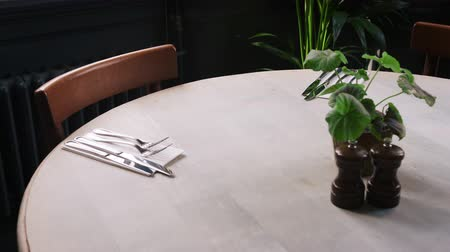 cutlery : Close up of table and chairs set for service in restaurant